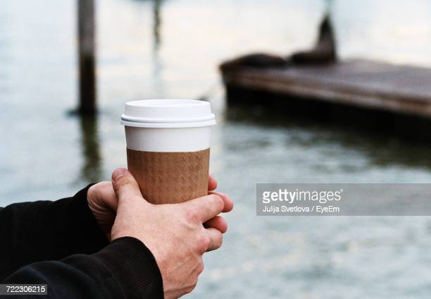 Cropped Image Of Man Holding Disposable Coffee Cup