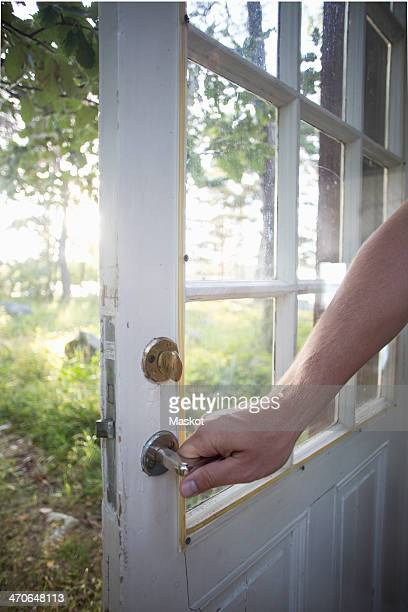 Cropped image of man holding door handle