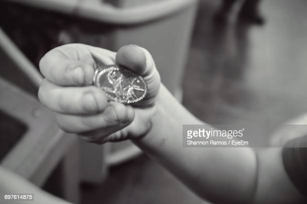 cropped image of man holding penny - penny for the guy stock photos and pictures