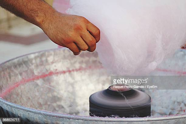 Cropped Image Of Man Making Cotton Candy