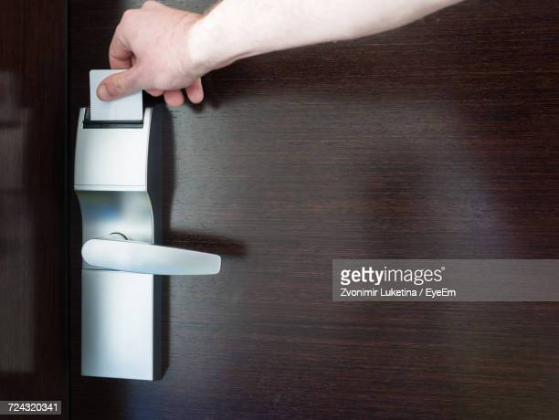 Cropped Image Of Man Opening Door With Key Card At Hotel