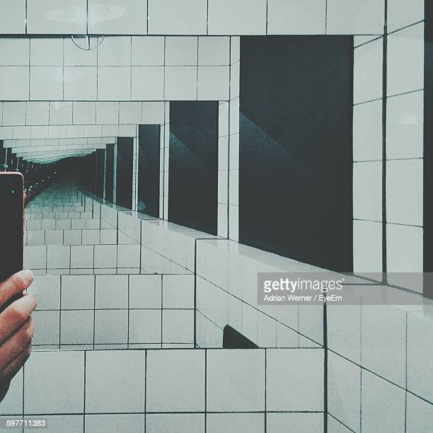 Cropped Image Of Man Photographing Mirror