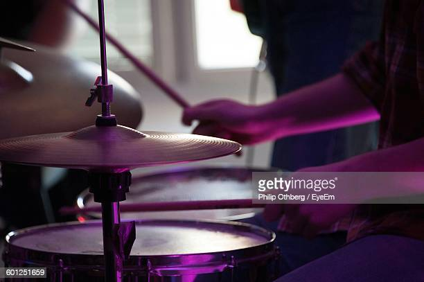 Cropped Image Of Man Playing Drums