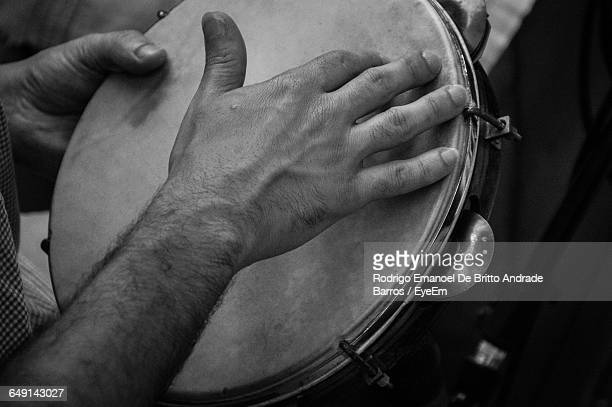 Cropped Image Of Man Playing Tambourine