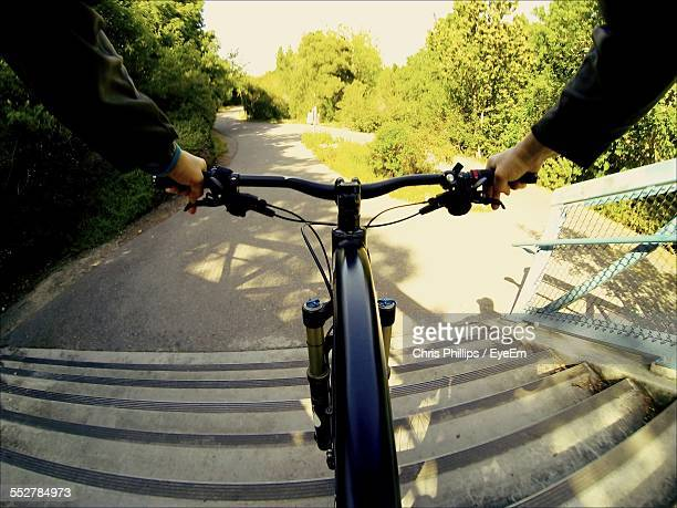 Cropped Image Of Man Riding Bicycle On Staircase