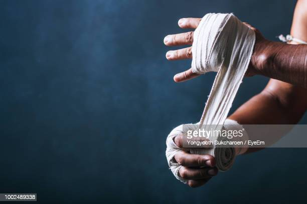 Cropped Image Of Man Typing Bandage On Hand