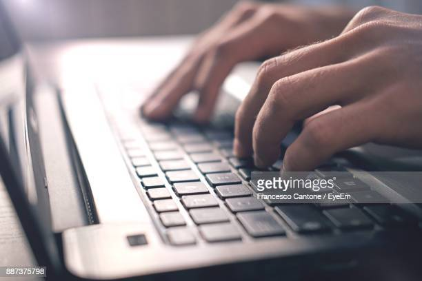 cropped image of man using laptop - computer keyboard stock pictures, royalty-free photos & images