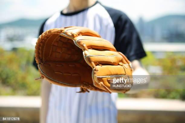 cropped image of man wearing baseball glove - キャッチャーミット ストックフォトと画像