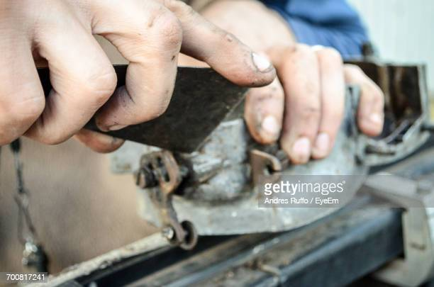 cropped image of man working in industry - andres ruffo stock pictures, royalty-free photos & images
