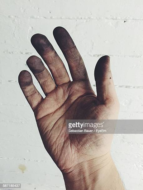 Cropped Image Of Messy Hand Against Wall