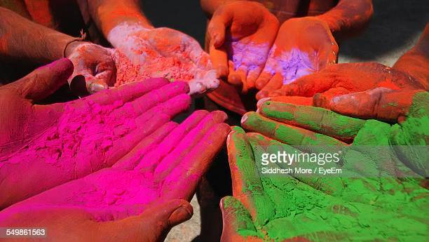 Cropped Image Of Multi Colored Hands During Holi