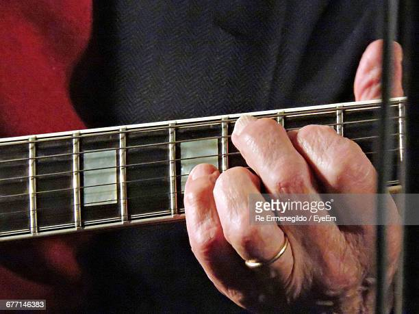 Cropped Image Of Musician Playing Guitar
