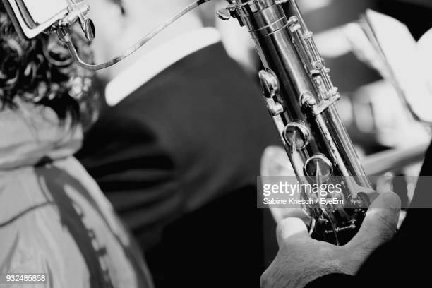 Cropped Image Of Musician Playing Wind Instrument