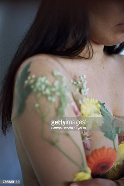 Cropped Image Of Naked Woman Covered With Flowers