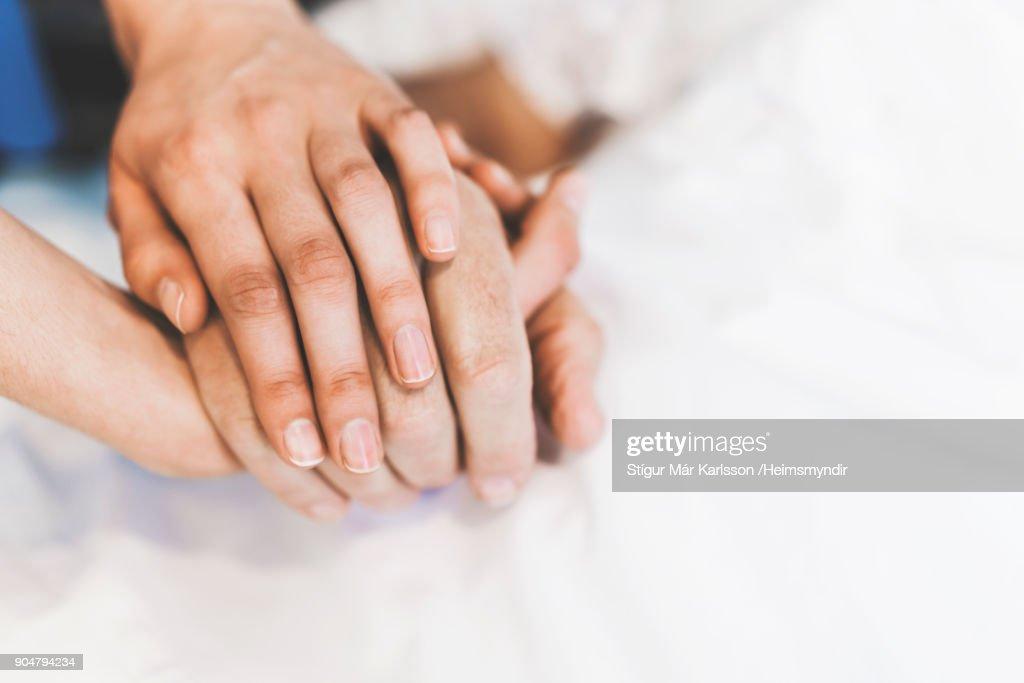 Cropped image of nurse holding man's hand : Stock Photo