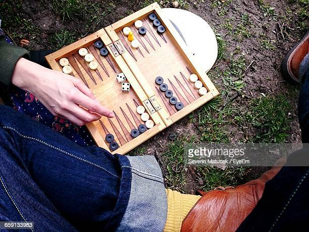 cropped image of people playing backgammon on field - backgammon stock pictures, royalty-free photos & images