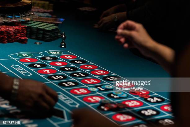 Cropped Image Of People Playing On Gambling Table In Casino