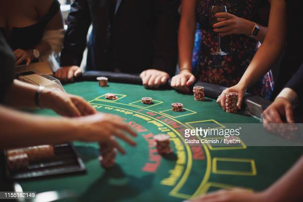 cropped image of people playing poker - casino stock pictures, royalty-free photos & images