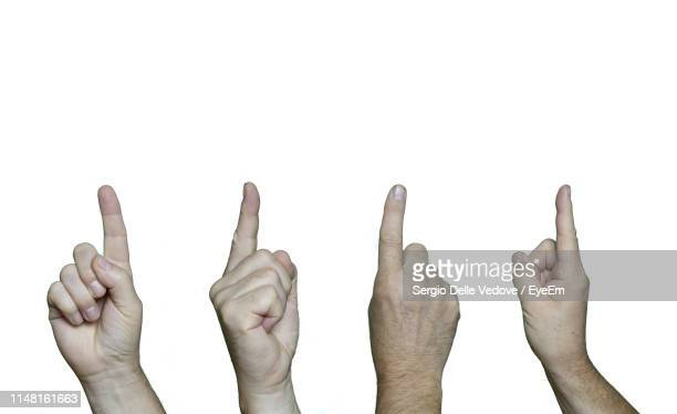cropped image of people pointing against white background - 人差し指 ストックフォトと画像