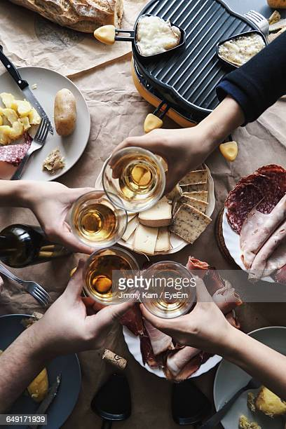 Cropped Image Of People Toasting Wineglass At Table