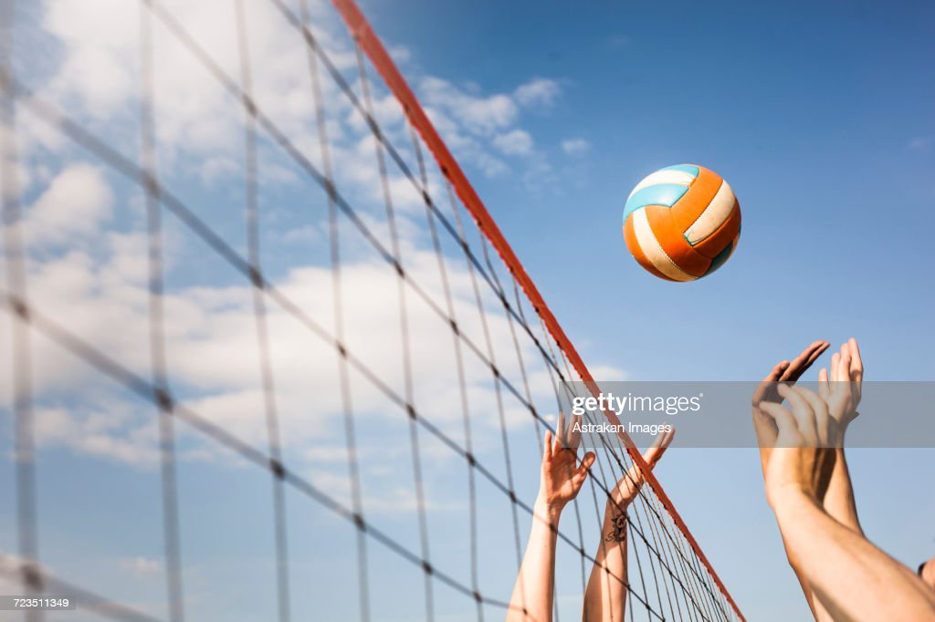 Cropped image of people Volleyball at beach : Stock Photo