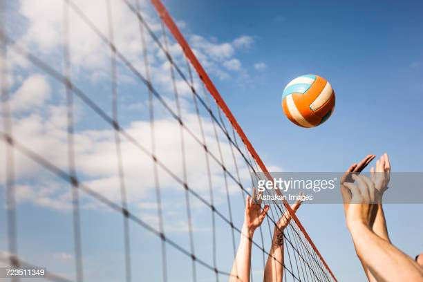cropped image of people volleyball at beach - beachvolleybal stockfoto's en -beelden
