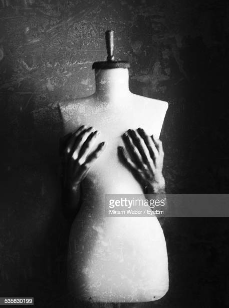 cropped image of person covering mannequin breasts - dressmaker's model stock photos and pictures
