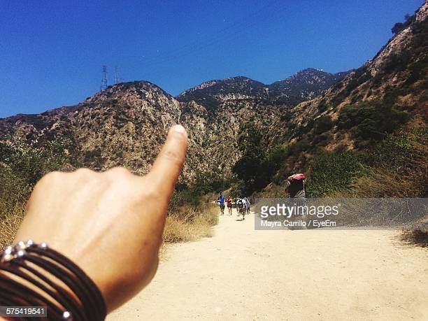 Cropped Image Of Person Hand Pointing At San Gabriel Mountains