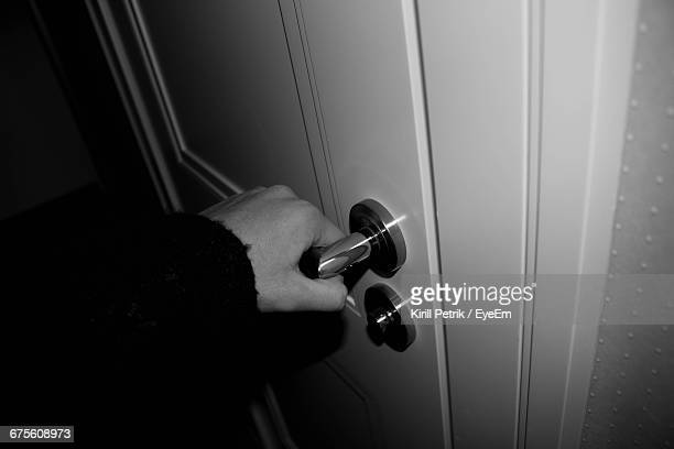 Cropped Image Of Person Hand Turning Doorknob