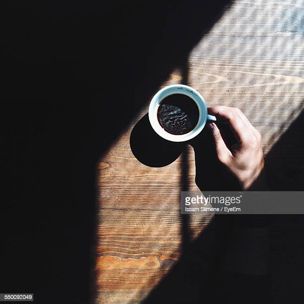 Cropped Image Of Person Having Coffee At Home