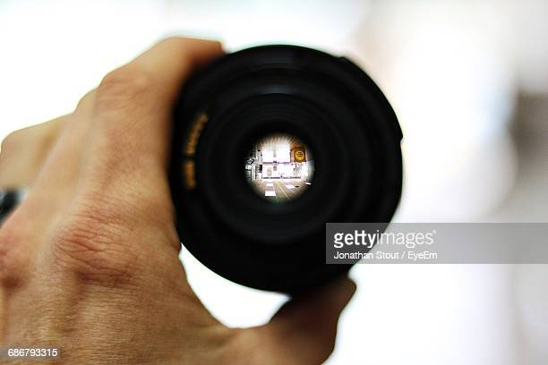 Cropped Image Of Person Holding A Lens