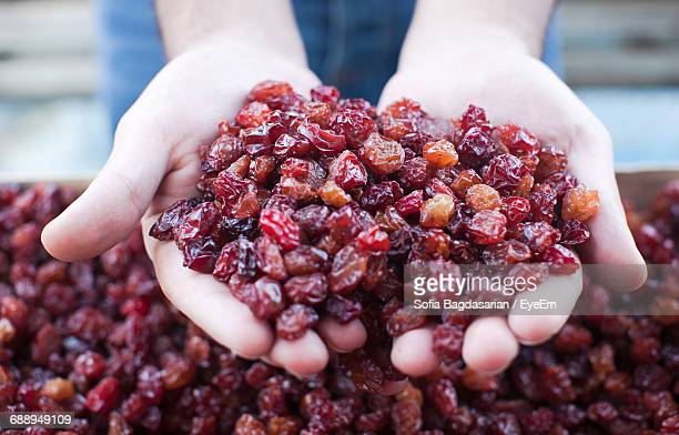 Cropped Image Of Person Holding Dried Cherries In Market