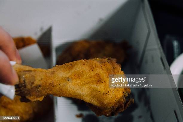 Cropped Image Of Person Holding Fresh Fried Chicken