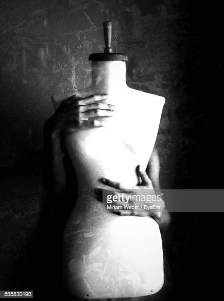 Cropped Image Of Person Holding Mannequin
