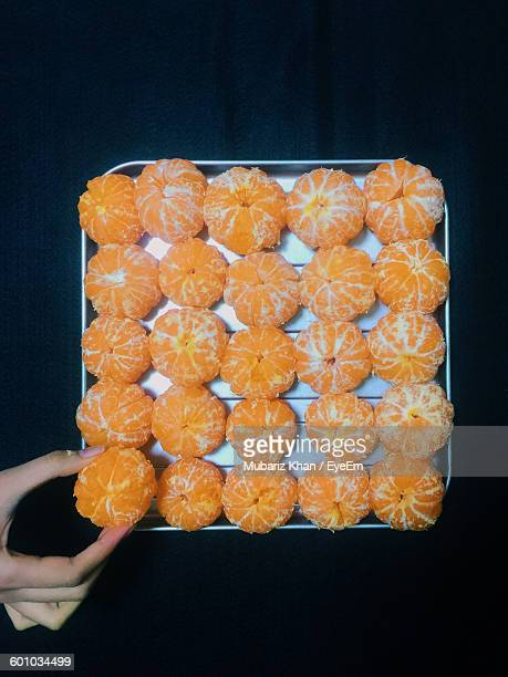 Cropped Image Of Person Holding Oranges In Serving Tray