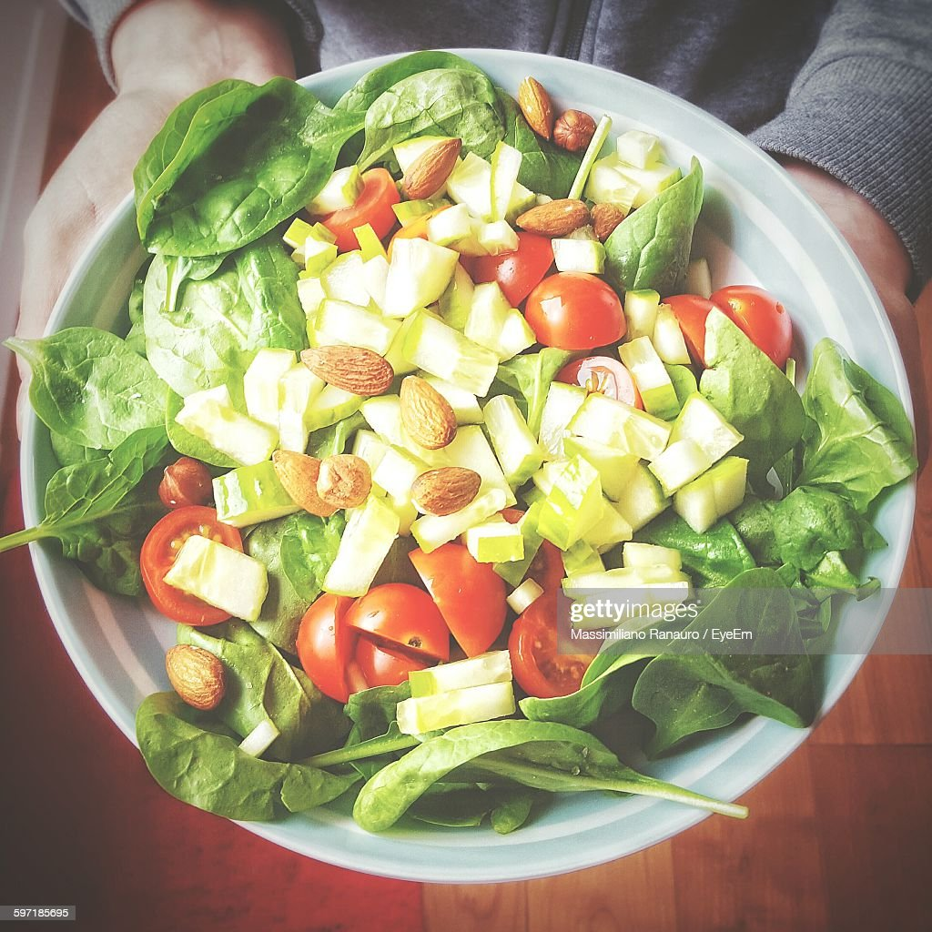 Cropped Image Of Person Holding Salad In Plate : Stock Photo