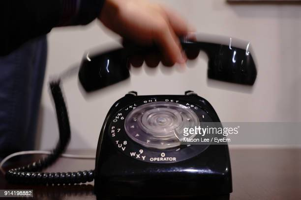 Cropped Image Of Person Holding Telephone Receiver