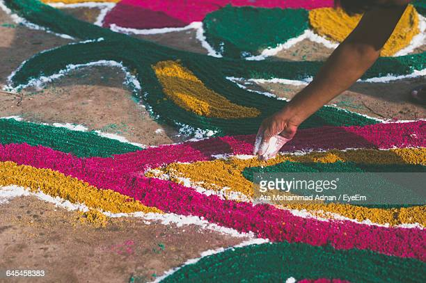 Cropped Image Of Person Making Rangoli