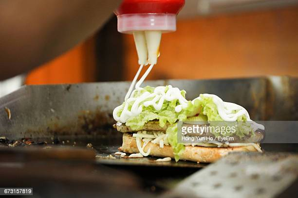 cropped image of person making sandwich - mayonnaise stock photos and pictures