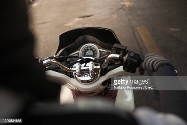 cropped image of person on scooter - moped stock photos and pictures
