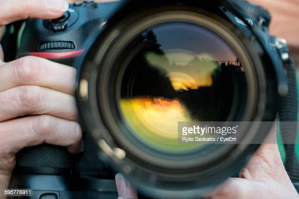 Cropped Image Of Person Photographing With Camera