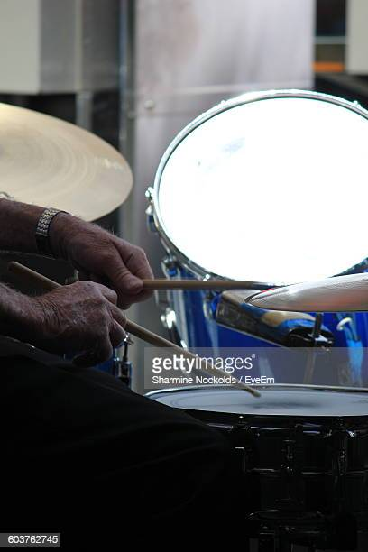Cropped Image Of Person Playing Drum