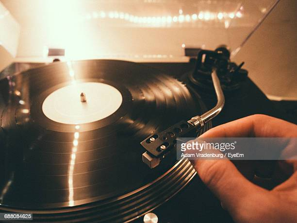 cropped image of person plying turntable - deck stock pictures, royalty-free photos & images