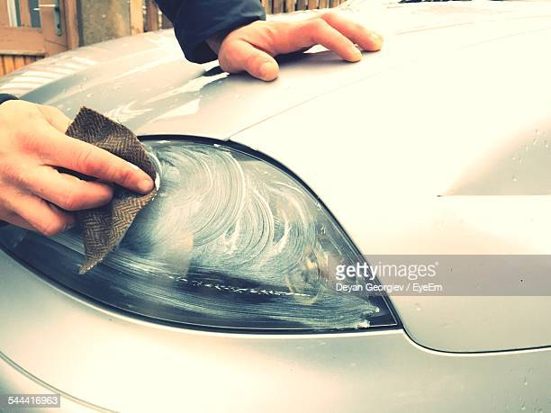 Cropped Image Of Person Polishing Car