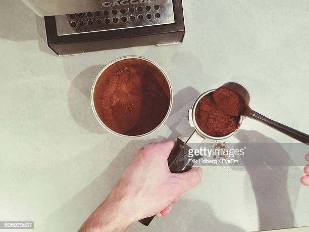 Cropped Image Of Person Preparing Coffee At Table