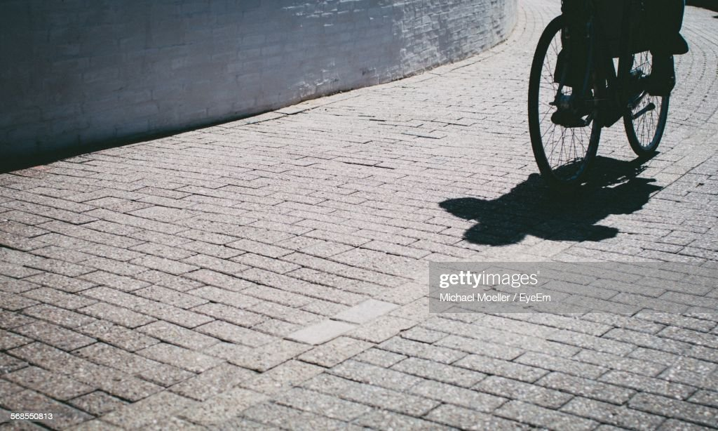 Cropped Image Of Person Riding Bicycle On Street : Stock Photo