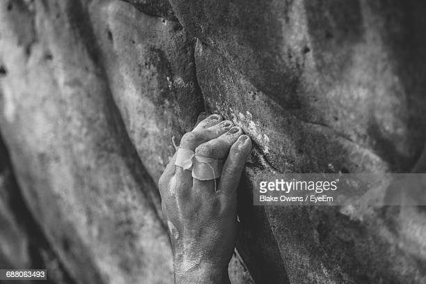 Cropped Image Of Person Rock Climbing