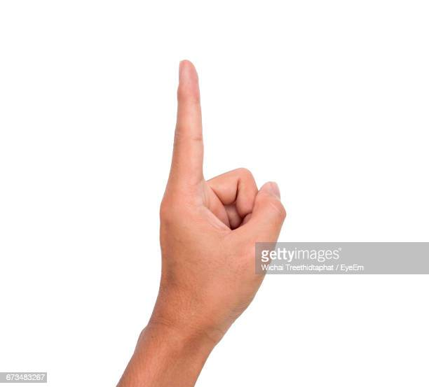 cropped image of person showing index finger against white background - index finger stock pictures, royalty-free photos & images