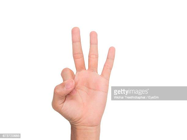 cropped image of person showing three fingers against white background - terceiro lugar - fotografias e filmes do acervo