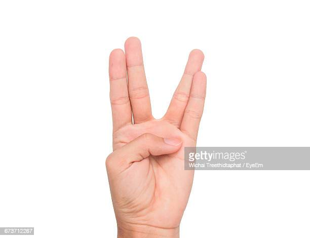 cropped image of person showing vulcan salute sign against white background - vulcan salute stock pictures, royalty-free photos & images